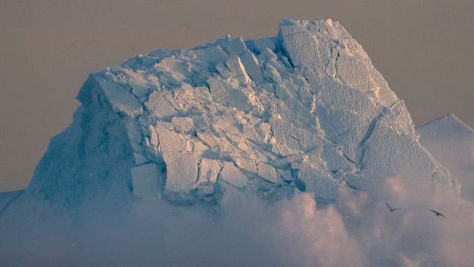 An iceberg collapses